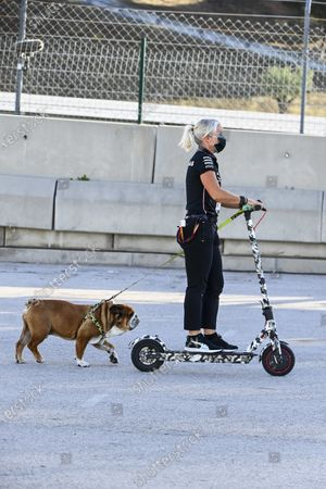 Angela Cullen, Physio for Lewis Hamilton on a scooter with the dog of Lewis Hamilton, Mercedes-AMG Petronas F1