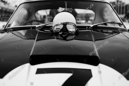 A helmet is placed on the bonnet of the Rob Walker Stirling Moss Ferrari 250 GT SWB. Photo: Nick Dungan/Goodwood