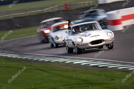 Mark Midgely/John Young Jaguar E-type FHC, waves in the Stirling Moss Memorial Trophy. Photo: Nick Dungan/Goodwood