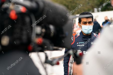 Karun Chandhok is intervied for television. Photo: Nick Dungan/Goodwood