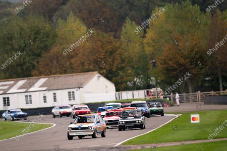 Stock Image of Tom Burgess/Karun Chandhok Ford Fiesta, leads Chris Harris/Orlando Lindsay Triumph Dolomite Sprint in race three, the Gerry Marshall Trophy. Photo: Nick Dungan/Goodwood