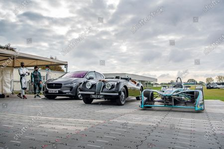 A line-up of Jaguars, including I-Pace, XK120 and Formua E car. Mitch Evans and Karun Chandhok stand by. Photo: Jayson Fong/Goodwood