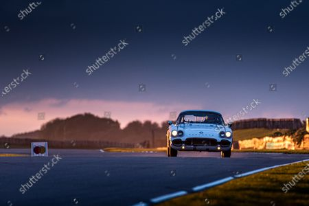Peter James/Alan Letts, Chevrolet Corvette C1, at dusk in race seven, the Stirling Moss Memorial Trophy. Photo: Jayson Fong/Goodwood