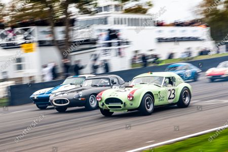 Stock Image of Race 14, the Royal Automobile Club TT Celebration. The Joe twyman/Edward Jones #23 AC Cobra, leads an E-Type and the Craig Davies/Jason Plato Chevrolet Corvette Sting Ray at the start.
