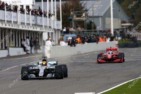 Esteban Gutierez, Mercedes-AMG W08 leads Marc Gene, Ferrari F60.