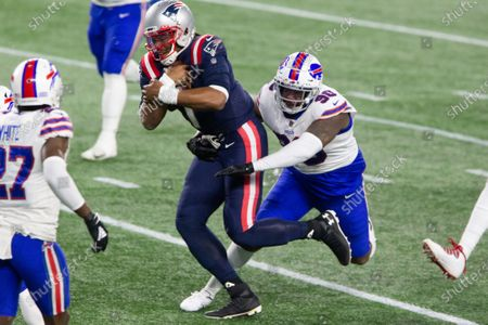 Stock Picture of New England Patriots quarterback Cam Newton (1) charges into the end zone while grabbed by Buffalo Bills defensive lineman Quinton Jefferson on a nine-yard touchdown carry in the second quarter at Gillette Stadium in Foxborough, Massachusetts