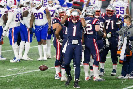 New England Patriots quarterback Cam Newton (1) adjusts his helmet in the second quarter against the Buffalo Bills at Gillette Stadium in Foxborough, Massachusetts
