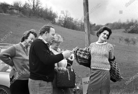 Mary Handley-Page (right, removing jacket) appearing to be presented with Austin Healey 3000 bottle of Chianti.