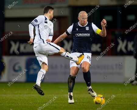 Kevin Cawley of Alloa Athletic challenges for the ball with Charlie Adam of Dundee; Dens Park, Dundee, Scotland; Scottish Championship Football, Dundee FC versus Alloa Athletic.