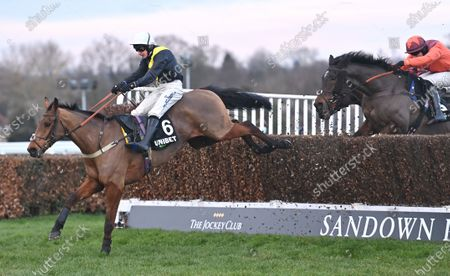 (L) Seeyouatmidnight (Ryan Mania) takes the last before going on to win The Unibet Veterans Handicap Steeple Chase. Photo © Hugh Routledge.