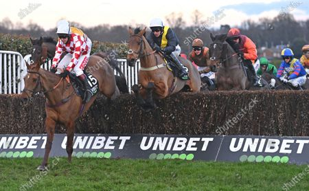 (C-yellow band) Seeyouatmidnight (Ryan Mania) takes a ditch before going on to win The Unibet Veterans Handicap Steeple Chase. Photo © Hugh Routledge.