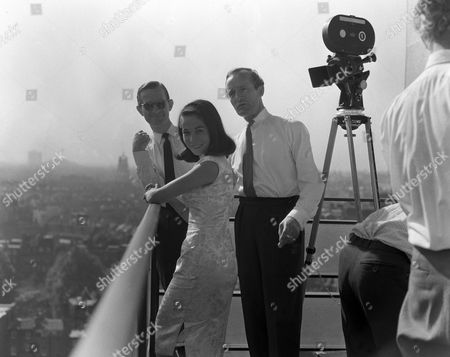 Nancy Kwan with Forbes Taylor during the filming of 'Shooting Stars'