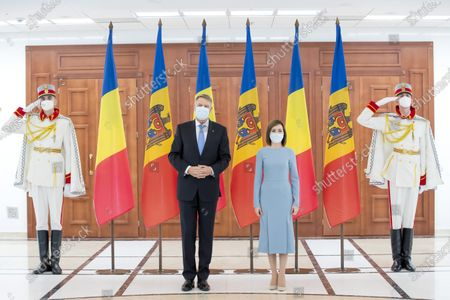 Romania's President Klaus Iohannis (L) and Moldova's President Maia Sandu (R) pose for a photograph during their meeting at the Presidential Palace, in Chisinau, Moldova, 29 December 2020. President Iohannis is in Chisinau at the invitation of President Sandu. He is the first high-level visit to Chisinau after the investiture of Maia Sandu as President.