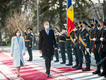 Romania's President Klaus Iohannis (C) reviews the honor guard with Moldova's President Maia Sandu (L) in front of the Presidential Palace during his first official visit in Chisinau, Moldova, 29 December 2020. President Iohannis is in Chisinau at the invitation of President Sandu. He is the first high-level visit to Chisinau after the investiture of Maia Sandu as President.
