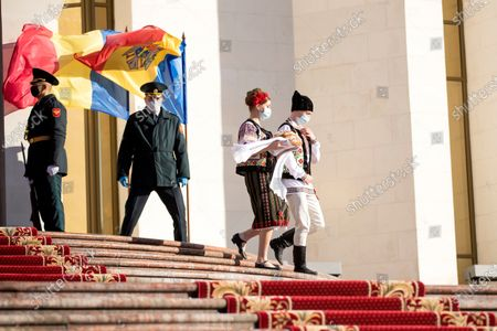 Dancers dressed in national clothes prepare to welcome Romania's President Klaus Iohannis (not pictured) for his arrival at the Presidential Palace, in Chisinau, Moldova, 29 December 2020. President Iohannis is in Chisinau at the invitation of President Sandu. He is the first high-level visit to Chisinau after the investiture of Maia Sandu as President.