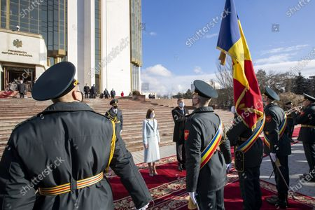 Romania's President Klaus Iohannis (C-R, back) reviews the honor guard with Moldova's President Maia Sandu (C, back) in front of the Presidential Palace in Chisinau, Moldova, 29 December 2020. President Iohannis is in Chisinau at the invitation of President Sandu. He is the first high-level visit to Chisinau after the investiture of Maia Sandu as President.