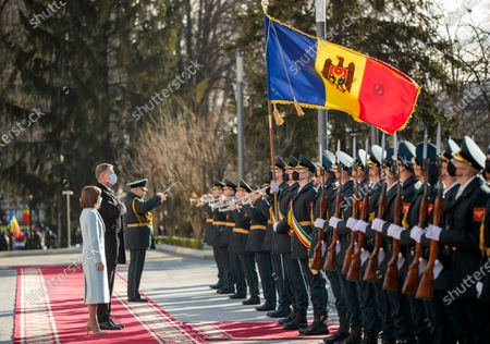 Romania's President Klaus Iohannis (2-L) reviews the honor guard with Moldova's President Maia Sandu (L) in front of the Presidential Palace in Chisinau, Moldova, 29 December 2020. President Iohannis is in Chisinau at the invitation of President Sandu. He is the first high-level visit to Chisinau after the investiture of Maia Sandu as President.