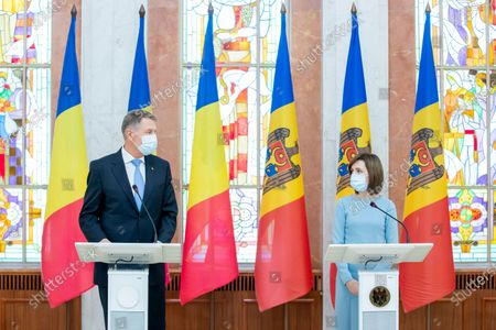 Moldova's President Maia Sandu (R) and Romania President Klaus Iohannis (L) during a at joint press conference during his first official visit in Chisinau, Moldova, 29 December 2020.  President Iohannis is in Chisinau at the invitation of President Sandu. He is the first high-level visit to Chisinau after the investiture of Maia Sandu as President.
