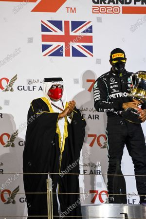 Sheikh Abdullah bin Hamad bin Isa Al Khalifa and Lewis Hamilton, Mercedes-AMG Petronas F1, 1st position, on the podium