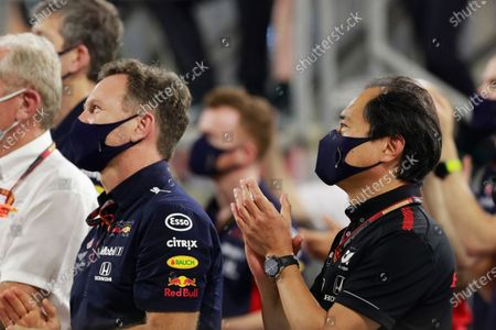 Helmut Marko, Consultant, Red Bull Racing, Christian Horner, Team Principal, Red Bull Racing, and Toyoharu Tanabe, F1 Technical Director, Honda, applaud their drivers on the podium