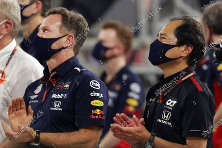 Stock Image of Christian Horner, Team Principal, Red Bull Racing, and Toyoharu Tanabe, F1 Technical Director, Honda, applaud their drivers on the podium