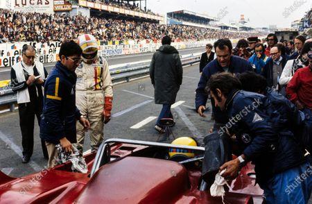 Rolf Stommelen / Giovanni Galli, Autodelta SpA, Alfa Romeo Tipo 33TT3, make a pitstop.