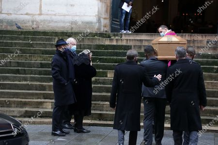 Alexandre Brasseur, Michele Cambon-Brasseur attend during the mass in homage to Claude Brasseur at Church of Saint Roch