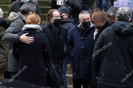 Daniel Russo, Fabien Onteniente attend during the mass in homage to Claude Brasseur at Church of Saint Roch