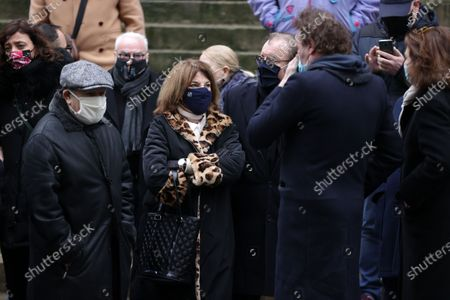 Jean Benguigui, Nicole Calfan, Jean-Paul Rouve attend during the mass in homage to Claude Brasseur at Church of Saint Roch