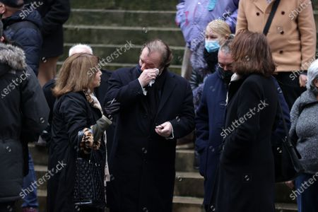 Stock Photo of Nicole Calfan, Daniel Russo attend during the mass in homage to Claude Brasseur at Church of Saint Roch