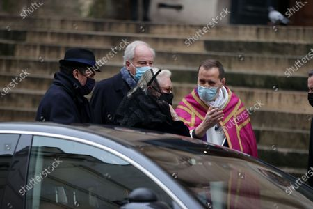 Stock Image of Alexandre Brasseur, Michele Cambon-Brasseur and family attend during at the mass in homage to Claude Brasseur at Church of Saint Roch