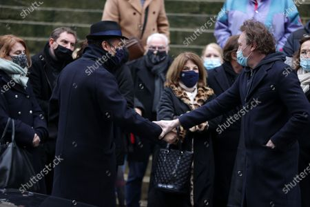 Stock Photo of Alexandre Brasseur, Jean-Paul Rouve attend during the mass in homage to Claude Brasseur at Church of Saint Roch