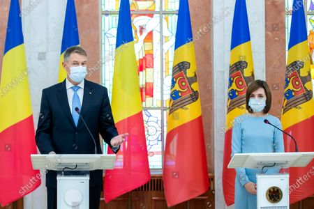 The President of Romania Klaus Iohannis (L) speaks during a joint press-conference with Moldova's President Maia Sandu (R) in the Presidential Palace, during his first official visit in Chisinau, Moldova, 29 December 2020.