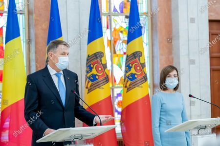 Stock Picture of The President of Romania Klaus Iohannis (L) speaks during a joint press-conference with Moldova's President Maia Sandu (R) in the Presidential Palace, during his first official visit in Chisinau, Moldova, 29 December 2020.