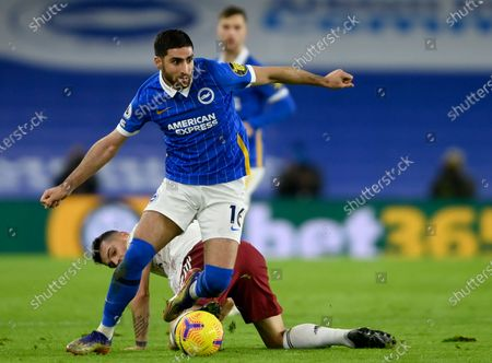 Alireza Jahanbakhsh (front) of Brighton in action during the English Premier League soccer match between Brighton & Hove Albion FC and Arsenal London in Brighton, Britain, 29 December 2020.