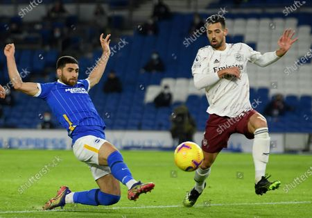 Alireza Jahanbakhsh (L) of Brighton in action against Pablo Mari (R) of Arsenal during the English Premier League soccer match between Brighton & Hove Albion FC and Arsenal London in Brighton, Britain, 29 December 2020.