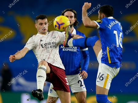 Alireza Jahanbakhsh (R) of Brighton in action against Kieran Tierney (L) of Arsenal during the English Premier League soccer match between Brighton & Hove Albion FC and Arsenal London in Brighton, Britain, 29 December 2020.
