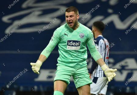 West Bromwich Albion's goalkeeper Sam Johnstone reacts during the English Premier League soccer match between West Bromwich Albion and Leeds United at the Hawthorns stadium, West Bromwich, England, Tuesday, Dec., 29, 2020