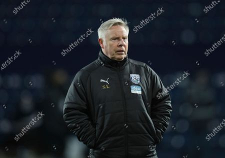 West Bromwich Albion assistant manager Sammy Lee looks on before the English Premier League soccer match between West Bromwich Albion and Leeds United at the Hawthorns stadium, West Bromwich, England, Tuesday, Dec., 29, 2020