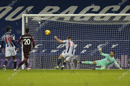 West Bromwich goalkeeper Sam Johnstone (R) concedes a goal during the English Premier League soccer match between West Bromwich Albion FC and Leeds United in West Bromwich, Britain, 29 December 2020.