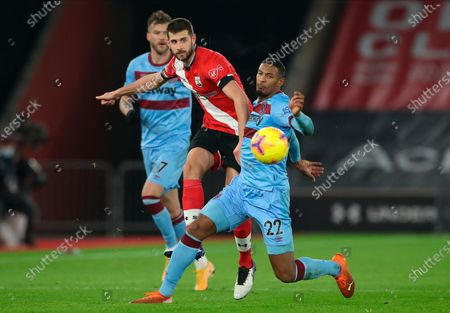 Southampton's Jack Stephens (L) and West Ham's Sebastien Haller (R) in action during the English Premier League soccer match between Southampton vs West Ham United in Southampton, Britain, 29 December 2020.