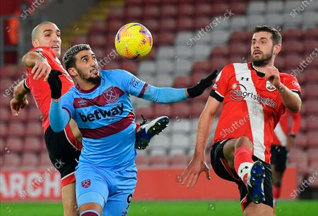 Southampton's Jack Stephens (L) in action with West Ham's Said Benrahma (2-nd L) during the English Premier League soccer match between Southampton vs West Ham United in Southampton, Britain, 29 December 2020.