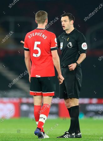 Southampton's Jack Stephens (L) argues with Main referee Andy Madley (R) during the English Premier League soccer match between Southampton vs West Ham United in Southampton, Britain, 29 December 2020.