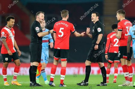 Southampton's Jack Stephens (3-rd  L) argues with main referee Andy Madley (2-nd R) during the English Premier League soccer match between Southampton vs West Ham United in Southampton, Britain, 29 December 2020.