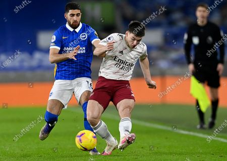 Alireza Jahanbakhsh (L) of Brighton in action against Kieran Tierney of Arsenal during the English Premier League soccer match between Brighton & Hove Albion FC and Arsenal London in Brighton, Britain, 29 December 2020.