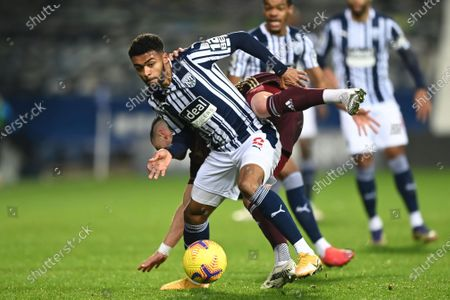 West Bromwich's Darnell Furlong (L) in action against Leeds' Jack Harrison (R) during the English Premier League soccer match between West Bromwich Albion FC and Leeds United in West Bromwich, Britain, 29 December 2020.