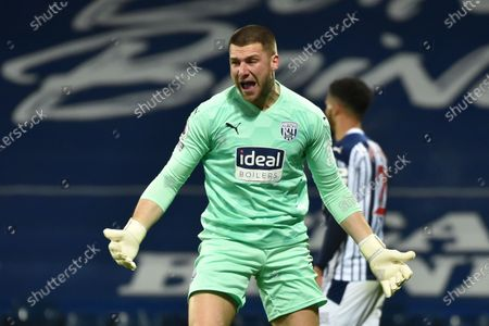 West Bromwich goalkeeper Sam Johnstone reacts after he concedes the 0-2 goal during the English Premier League soccer match between West Bromwich Albion FC and Leeds United in West Bromwich, Britain, 29 December 2020.