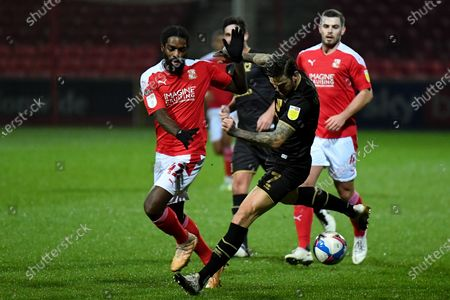 Swindon Town midfielder Anthony Grant (42)  battles for possession  with Milton Keynes Dons midfielder Ben Gladwin (7) during the EFL Sky Bet League 1 match between Swindon Town and Milton Keynes Dons at the County Ground, Swindon