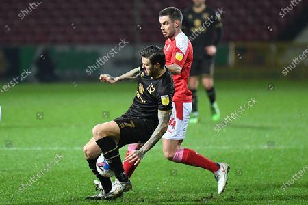 Swindon Town defender Dion Conroy (4) tackles Milton Keynes Dons midfielder Ben Gladwin (7) during the EFL Sky Bet League 1 match between Swindon Town and Milton Keynes Dons at the County Ground, Swindon