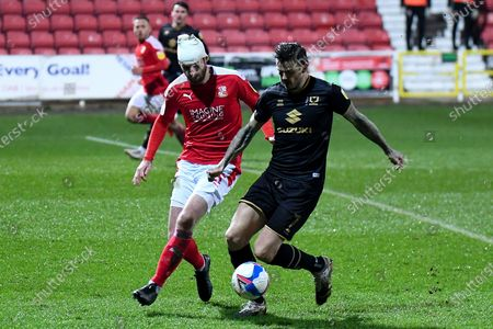 Swindon Town defender Jonathan Grounds (5) battles for possession  with Milton Keynes Dons midfielder Ben Gladwin (7) during the EFL Sky Bet League 1 match between Swindon Town and Milton Keynes Dons at the County Ground, Swindon